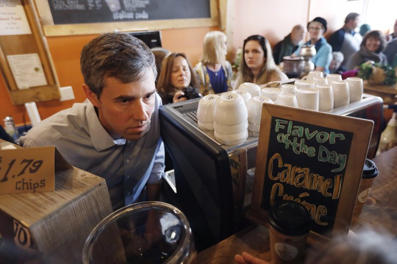 Former Texas congressman Beto O'Rourke talks with an audience member during a stop at the Central Park Coffee Company, Friday, March 15, 2019, in Mount Pleasant, Iowa. (AP Photo/Charlie Neibergall)