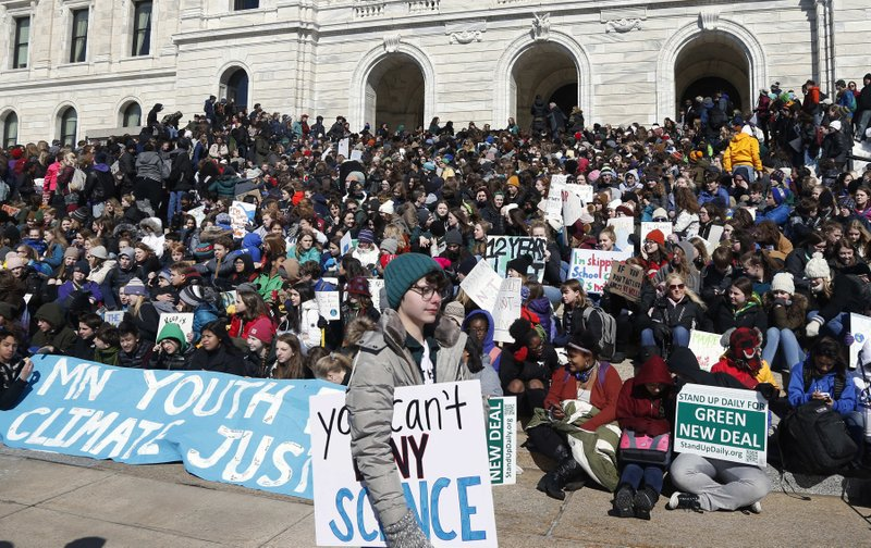 Around 1,000 Minnesota students skipped school to gather on the steps of the state Capitol Friday, March 15, 2019 in St. (AP Photo/Jim Mone)