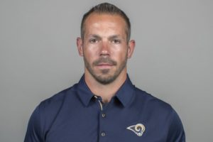 "LA Rams' ""get-back coach"" on leave after arrest, charges"