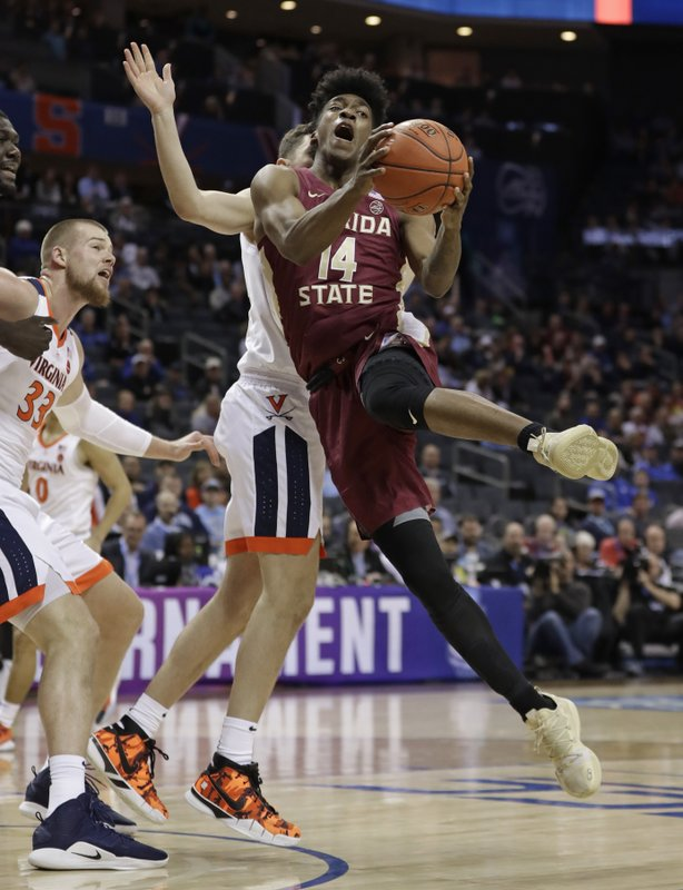 Florida State's Terance Mann (14) is fouled as he drives against against Virginia during the first half of an NCAA college basketball game in the Atlantic Coast Conference tournament in Charlotte, N. (AP Photo/Nell Redmond)