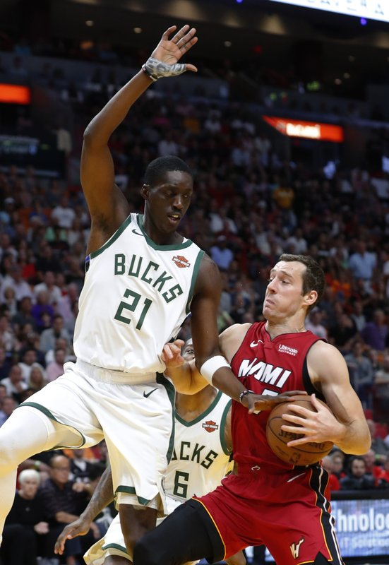 Miami Heat guard Goran Dragic goes up for a shot against Milwaukee Bucks guard Tony Snell (21) during the first half of an NBA basketball game Friday, March 15, 2019, in Miami. (AP Photo/Wilfredo Lee)