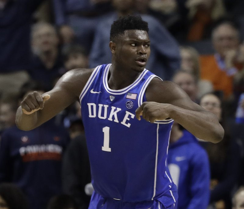 Duke's Zion Williamson (1) reacts after scoring against North Carolina during the second half of an NCAA college basketball game in the Atlantic Coast Conference tournament in Charlotte, N. (AP Photo/Chuck Burton)