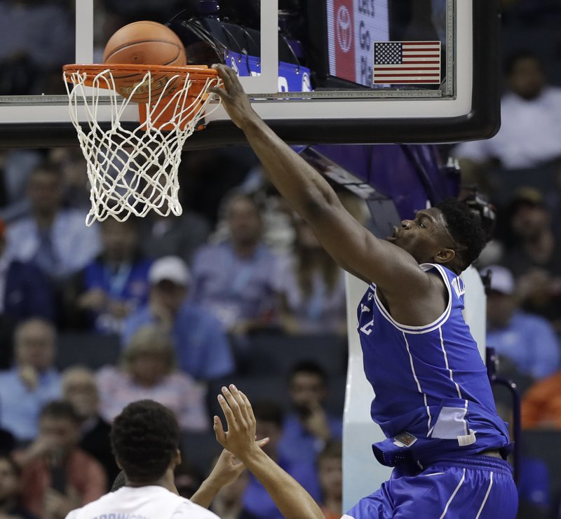 Zion Williamson (1) dunks during the second half of an NCAA college basketball game against North Carolina in the Atlantic Coast Conference tournament in Charlotte, N. (AP Photo/Chuck Burton)
