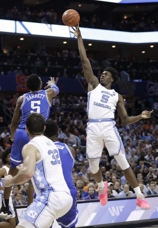 North Carolina's Nassir Little, right, shoots against Duke's R.J. Barrett, left, during the second half of an NCAA college basketball game in the Atlantic Coast Conference tournament in Charlotte, N. (AP Photo/Chuck Burton)