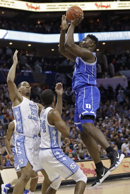 Duke's Zion Williamson (1) shoots against North Carolina's Garrison Brooks (15) during the first half of an NCAA college basketball game in the Atlantic Coast Conference tournament in Charlotte, N. (AP Photo/Chuck Burton)