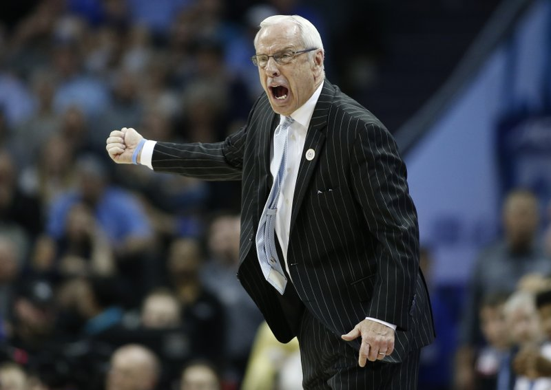 North Carolina head coach Roy Williams directs his team against Duke during the first half of an NCAA college basketball game in the Atlantic Coast Conference tournament in Charlotte, N. (AP Photo/Nell Redmond)