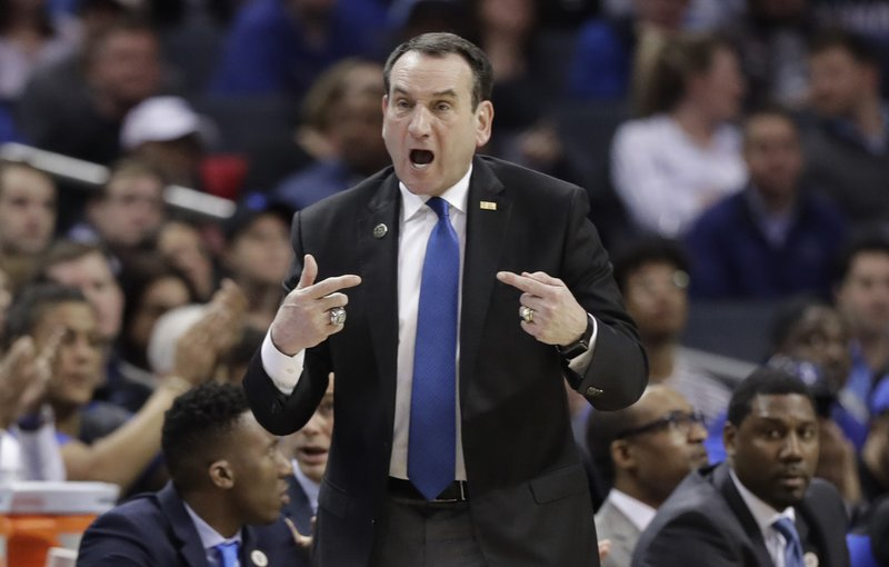 Duke head coach Mike Krzyzewski directs his team against North Carolina during the first half of an NCAA college basketball game in the Atlantic Coast Conference tournament in Charlotte, N. (AP Photo/Chuck Burton)