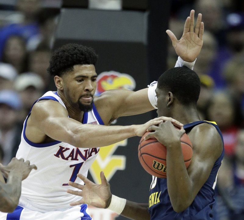 Kansas forward Dedric Lawson (1) covered West Virginia forward Lamont West, right, during the first half of an NCAA college basketball game in the semifinals of the Big 12 conference tournament in Kansas City, Mo. (AP Photo/Orlin Wagner)