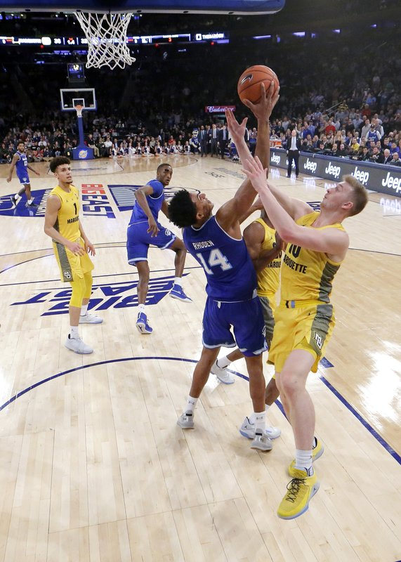 Seton Hall guard Jared Rhoden (14) competes for a rebound against Marquette forward Jamal Cain (23) and forward Sam Hauser (10) during the first half of an NCAA college basketball semifinal game in the Big East men's tournament, Friday, March 15, 2019, in New York. (AP Photo/Julio Cortez)