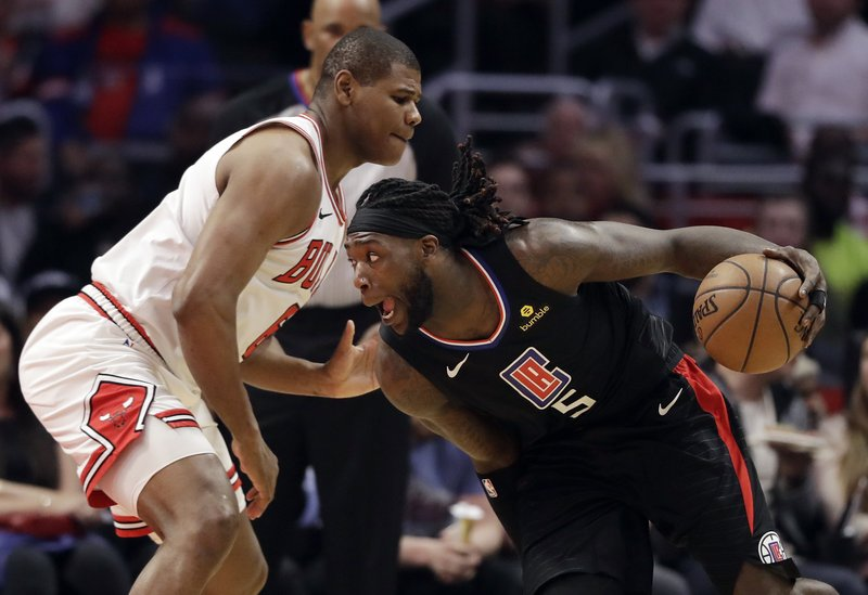 Los Angeles Clippers' Montrezl Harrell, right, is defended by Chicago Bulls' Cristiano Felicio during the first half of an NBA basketball game Friday, March 15, 2019, in Los Angeles. (AP Photo/Marcio Jose Sanchez)