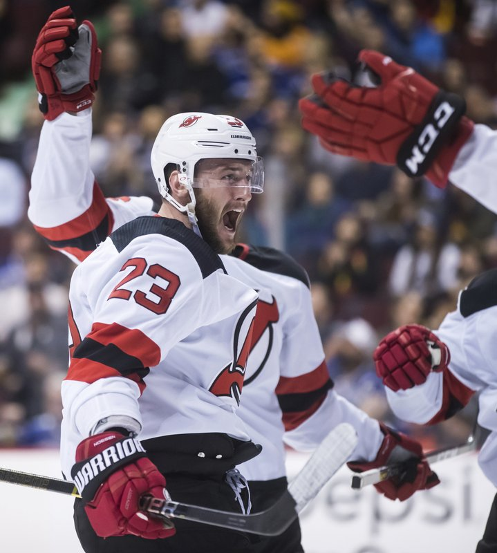 New Jersey Devils' Stefan Noesen celebrates his goal against the Vancouver Canucks during the third period of an NHL hockey game Friday, March 15, 2019, in Vancouver, British Columbia. (Darryl Dyck/The Canadian Press via AP)