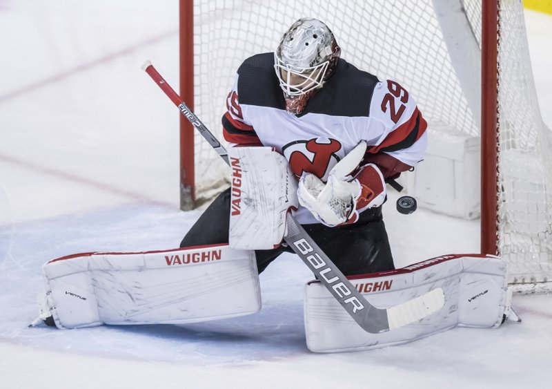 New Jersey Devils goalie MacKenzie Blackwood makes a save game against the Vancouver Canucks during the second period of an NHL hockey game Friday, March 15, 2019, in Vancouver, British Columbia. (Darryl Dyck/The Canadian Press via AP)