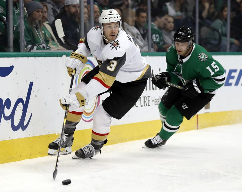 Vegas Golden Knights defenseman Brayden McNabb (3) controls the puck in front of Dallas Stars' Blake Comeau (15) in the first period of an NHL hockey game in Dallas, Friday, March 15, 2019. (AP Photo/Tony Gutierrez)