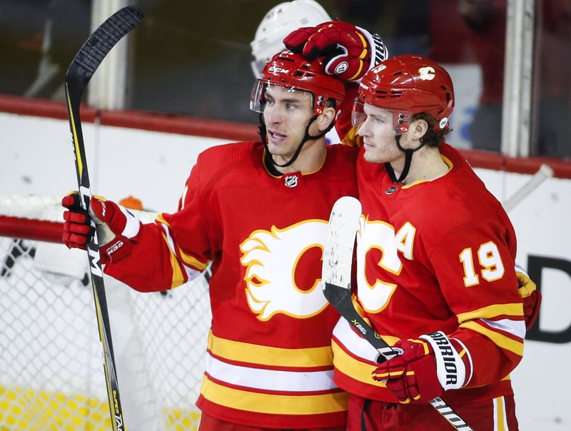 Calgary Flames' Garnet Hathaway, lefft, celebrates his goal with teammate Matthew Tkachuk during the second period of an NHL hockey game against the New York Rangers in Calgary, Alberta, Friday, March 15, 2019. (Jeff McIntosh/The Canadian Press via AP)