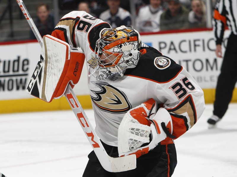 Anaheim Ducks goaltender John Gibson deflects the puck with his shoulder during the third period of the team's NHL hockey game against the Colorado Avalanche on Friday, March 15, 2019, in Denver. (AP Photo/David Zalubowski)