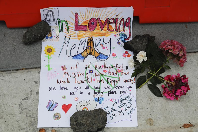 A message is displayed at a makeshift memorial outside Christchurch hospital in Christchurch, New Zealand, Saturday, March 16, 2019, one day after the mass shootings at two mosques in the city. (AP Photo/Vincent Thian)