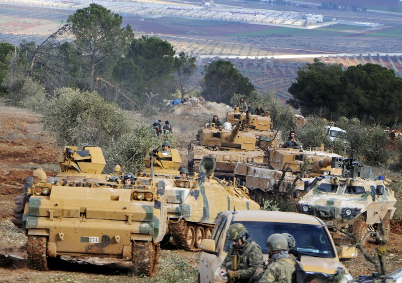 FILE -- In this Jan. 28, 2018 file photo, Turkish troops take control of Bursayah hill, which separates the Kurdish-held enclave of Afrin from the Turkey-controlled town of Azaz, Syria. (DHA-Depo Photos via AP, File)