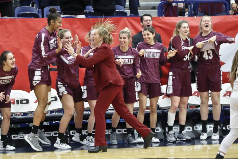Fordham head coach Stephanie Gaitley, center, celebrates with the team on the bench as time runs out to defeat VCU to win the Atlantic 10 tournament championship NCAA college basketball game, Sunday, March 10, 2019, in Pittsburgh. (AP Photo/Keith Srakocic)