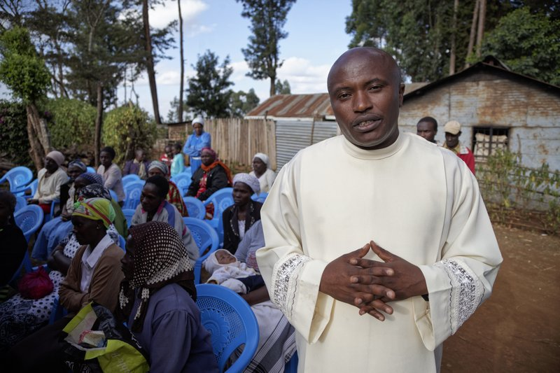 In this photo taken Thursday, March 14, 2019, Father Michael Wa Mugi speaks to The Associated Press at a prayers ceremony for Catholic priest Rev. (AP Photo/Sayyid Abdul Azim)