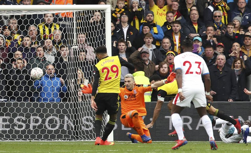 Watford's Etienne Capoue scores his side's first goal of the game  during the FA Cup quarter final soccer match between Watford and Crystal Palace , at Vicarage Road, in Watford, England, Saturday March 16, 2019. (Jonathan Brady/PA via AP)
