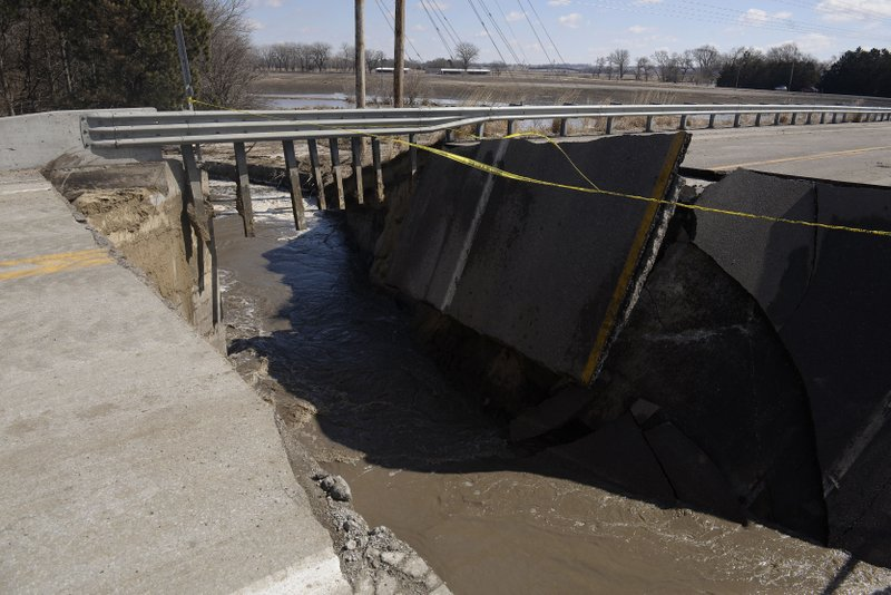 The approach to a bridge over the Elkhorn River, seen Friday afternoon, March 15, 2019, leading south out of Stanton, Neb. (Darin Epperly/The Norfolk Daily News via AP)