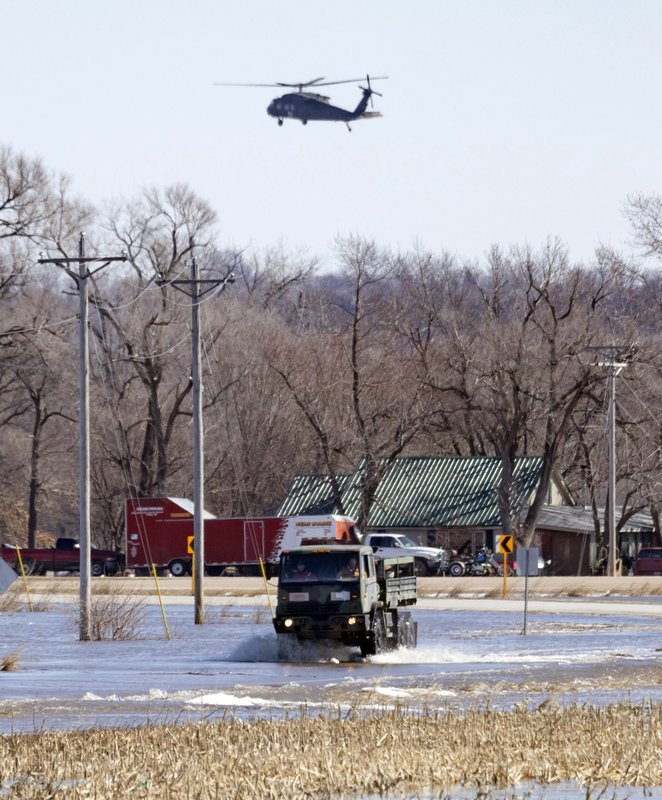 First responders bring out a truckload of residents from the King Lake area near Valley, Neb. because of flooding on Friday, March 15, 2019. (Kent Sievers/Omaha World-Herald via AP)