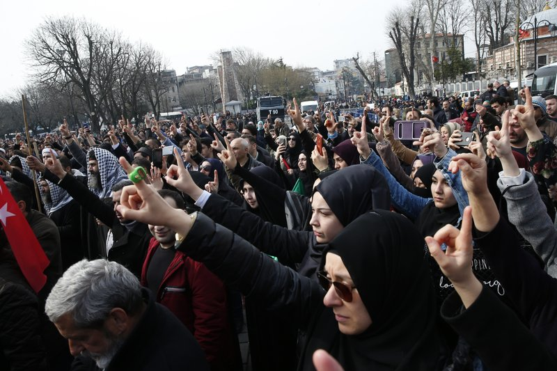 Demonstrators chant slogans against the mosque attacks in New Zealand during a protest in Istanbul, Saturday, March 16, 2019. (AP Photo/Lefteris Pitarakis)