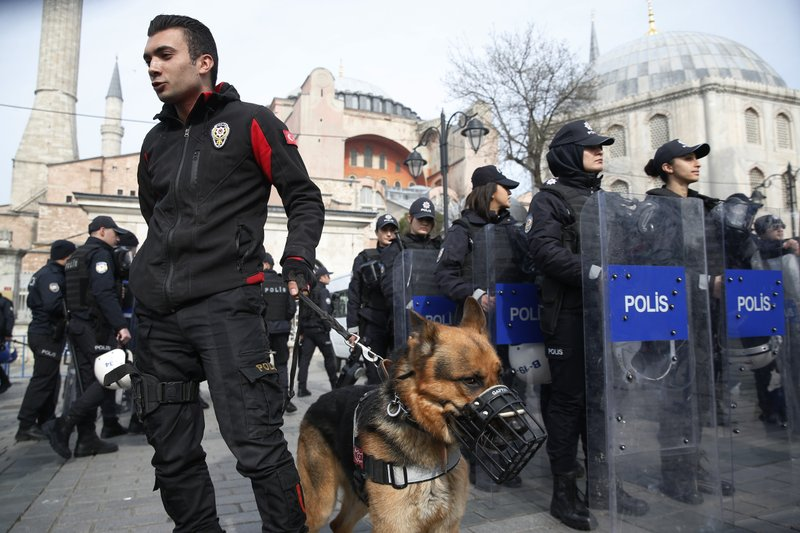 Backdropped by the Byzantine-era Hagia Sophia, Turkish police officers provide security during a protest against the mosque attacks in New Zealand in Istanbul, Saturday, March 16, 2019. (AP Photo/Lefteris Pitarakis)