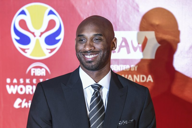 Former basketball player Kobe Bryant reacts prior to the draw ceremony of 2019 FIBA Basketball World Cup in Shenzhen, in southern China's Guangdong Province, Saturday, March 16, 2019. (Mao Siqian/Xinhua via AP)