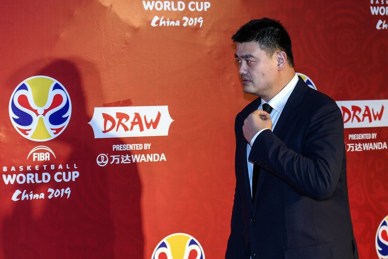Yao Ming, president of the Chinese Basketball Association and former NBA player walks, prior to the draw ceremony of 2019 FIBA Basketball World Cup in Shenzhen, in southern China's Guangdong Province, Saturday, March 16, 2019. (Mao Siqian/Xinhua via AP)