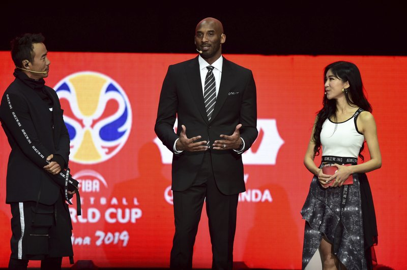 Former NBA basketball player and FIBA World Cup Ambassador Kobe Bryant, center, speaks during the draw ceremony for the 2019 FIBA Basketball World Cup in Shenzhen in southern China's Guangdong Province, Saturday, March 16, 2019. (Chinatopix via AP)