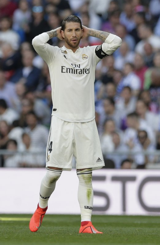 Real Madrid's Sergio Ramos gestures during a Spanish La Liga soccer match between Real Madrid and Celta at the Santiago Bernabeu stadium in Madrid, Spain, Saturday, March 16, 2019.(AP Photo/Paul White)
