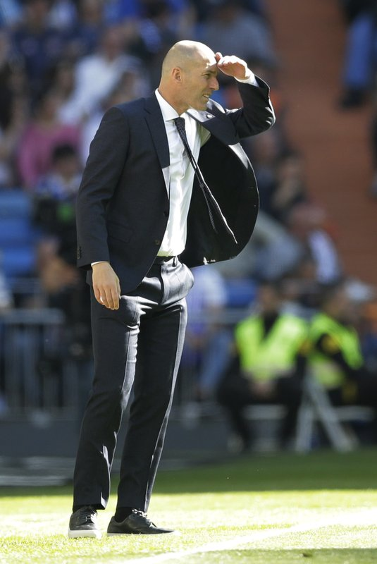 Real Madrid's coach Zinedine Zidane stands during a Spanish La Liga soccer match between Real Madrid and Celta at the Santiago Bernabeu stadium in Madrid, Spain, Saturday, March 16, 2019.(AP Photo/Paul White)