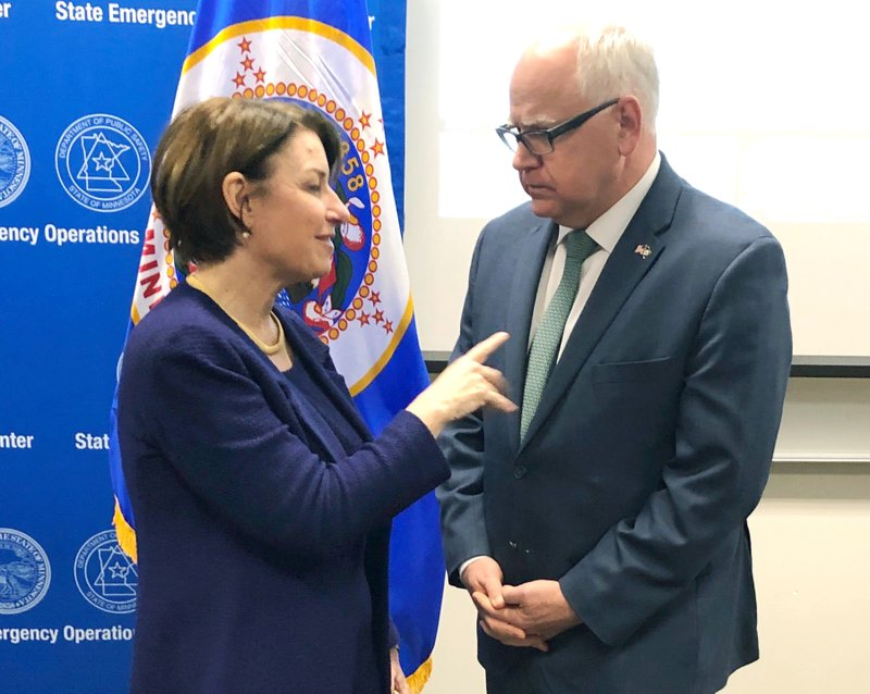 Minnesota Gov. Tim Walz, right, and Sen. Amy Klobuchar, D-Minn., talk before a briefing from state and federal emergency managers who are gearing up for a flood threat caused by some of the heaviest snow in years, Friday, March 15, 2019 in St. (AP Photo/Steve Karnowski)