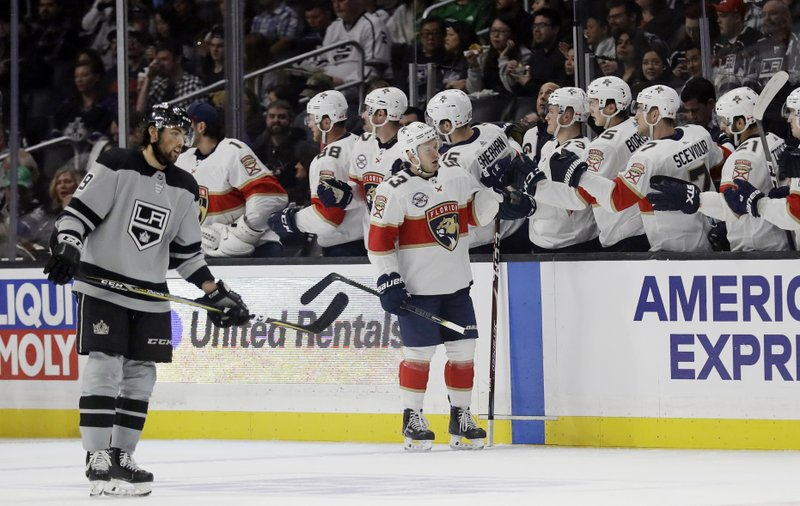 CORRECTS TO SECOND, NOT FIRST PERIOD - Florida Panthers' Evgenii Dadonov, center, celebrates with teammates after scoring against the Los Angeles Kings during the second period of an NHL hockey game Saturday, March 16, 2019, in Los Angeles. (AP Photo/Marcio Jose Sanchez)