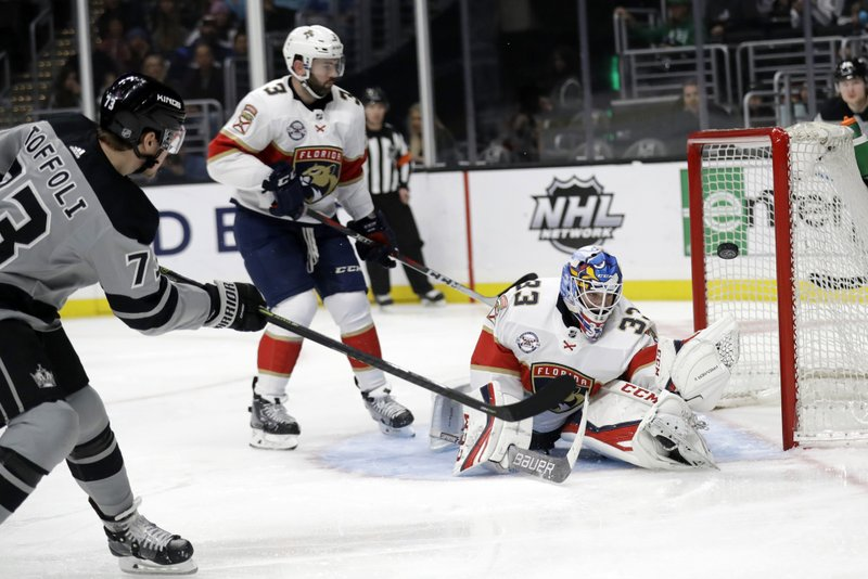 Florida Panthers goaltender Sam Montembeault, right, stops a shot from Los Angeles Kings' Tyler Toffoli, left, during the second period of an NHL hockey game Saturday, March 16, 2019, in Los Angeles. (AP Photo/Marcio Jose Sanchez)