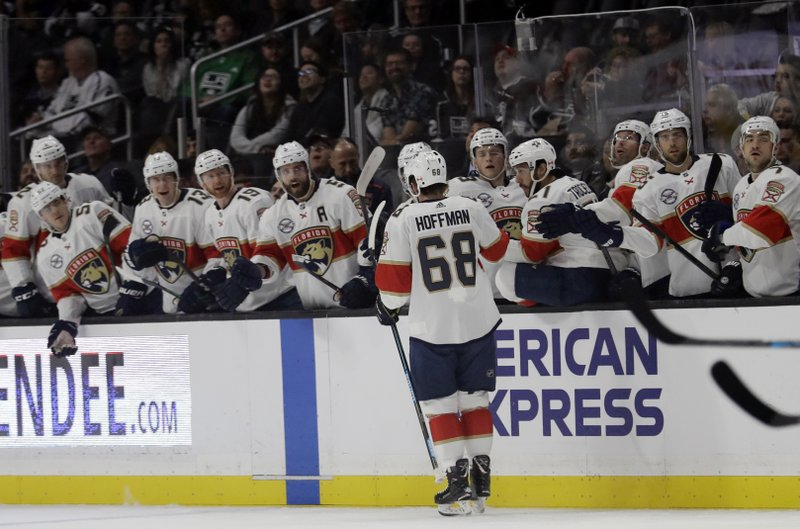 Florida Panthers' Mike Hoffman (68) celebrates his goal with teammates during the first period of an NHL hockey game Saturday, March 16, 2019, in Los Angeles. (AP Photo/Marcio Jose Sanchez)