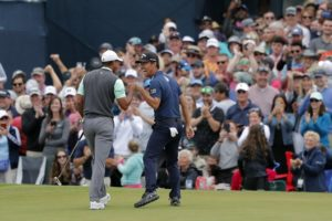 Woods lands birdie, laughs at famed 17 after quadruple-bogey