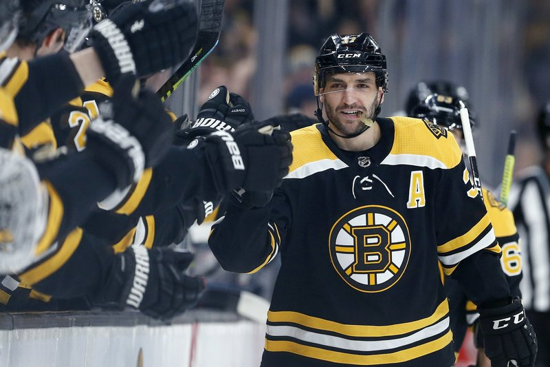 Boston Bruins' Patrice Bergeron celebrates his goal during the first period of the team's NHL hockey game against the Columbus Blue Jackets in Boston, Saturday, March 16, 2019. (AP Photo/Michael Dwyer)