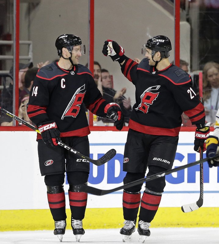 Carolina Hurricanes' Justin Williams (14) is congratulated by Nino Niederreiter (21), of the Czech Republic, following Williams' goal against the Buffalo Sabres during the second period of an NHL hockey game in Raleigh, N. (AP Photo/Gerry Broome)