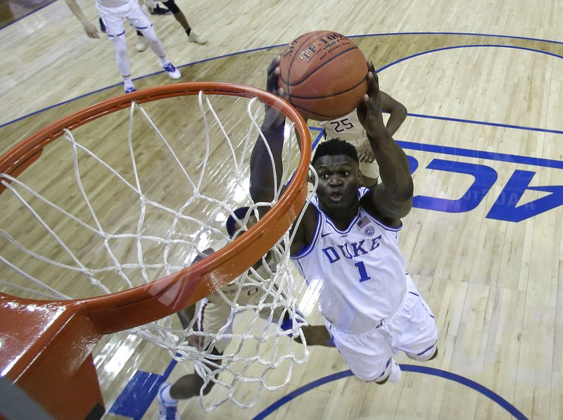 Duke's Zion Williamson (1) goes up to dunk against Florida State during the first half of the NCAA college basketball championship game of the Atlantic Coast Conference tournament in Charlotte, N. (AP Photo/Chuck Burton)