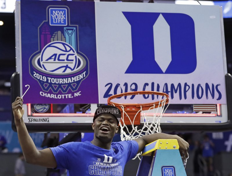 Duke's Zion Williamson celebrates Duke's win over Florida State after cutting a piece of a net after the NCAA college basketball championship game of the Atlantic Coast Conference tournament in Charlotte, N. (AP Photo/Nell Redmond)