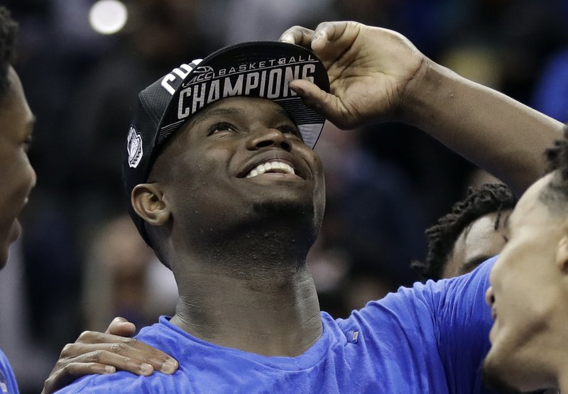 Duke's Zion Williamson celebrates after Duke defeated Florida State in the NCAA college basketball championship game of the Atlantic Coast Conference tournament in Charlotte, N. (AP Photo/Chuck Burton)