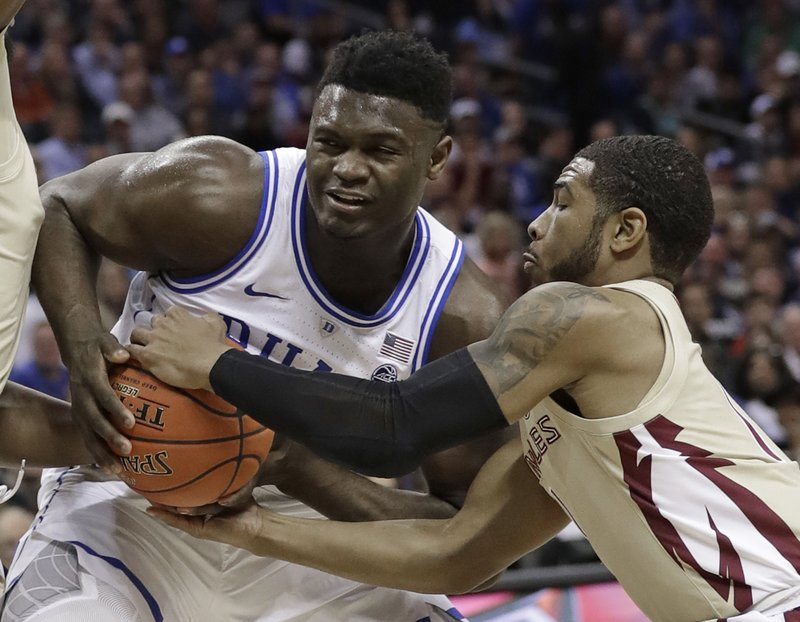 Florida State's David Nichols, right, steals the ball from Zion Williamson, left, during the first half of the NCAA college basketball championship game of the Atlantic Coast Conference tournament in Charlotte, N. (AP Photo/Chuck Burton)