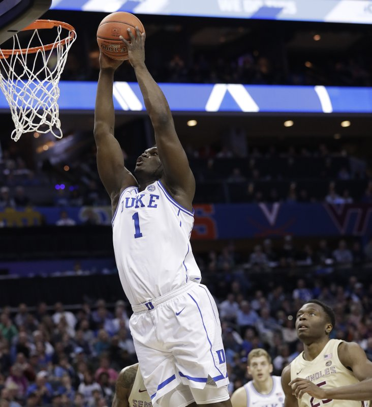 Duke's Zion Williamson (1) dunks against Florida State during the first half of the NCAA college basketball championship game of the Atlantic Coast Conference tournament in Charlotte, N. (AP Photo/Chuck Burton)