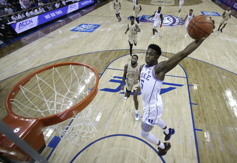 Duke's RJ Barrett (5) goes up to dunk against Florida State during the first half of the NCAA college basketball championship game of the Atlantic Coast Conference tournament in Charlotte, N. (AP Photo/Chuck Burton)