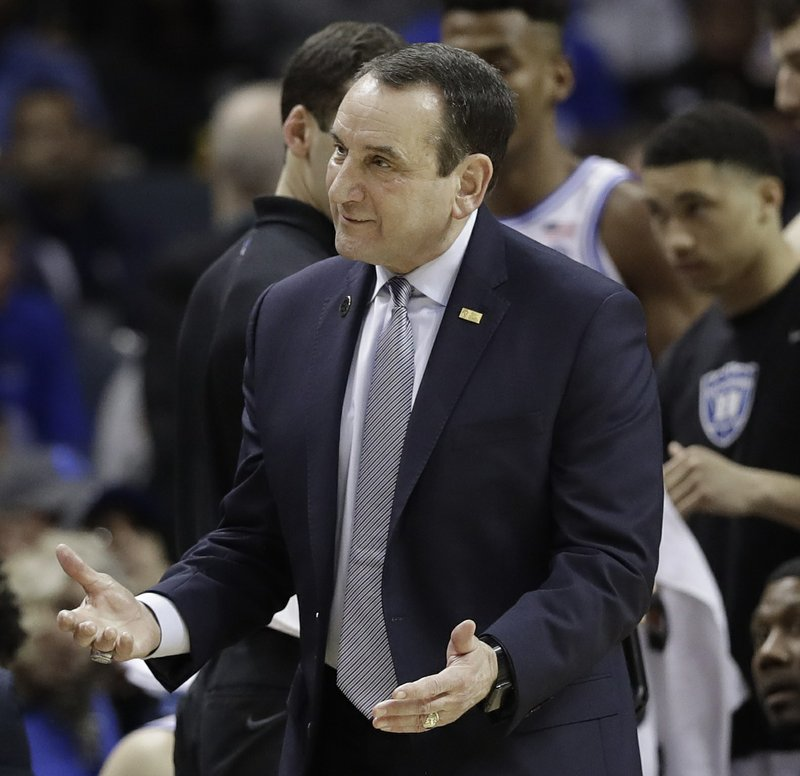 Duke head coach Mike Krzyzewski questions a call against Florida State during the first half of the NCAA college basketball championship game of the Atlantic Coast Conference tournament in Charlotte, N. (AP Photo/Chuck Burton)