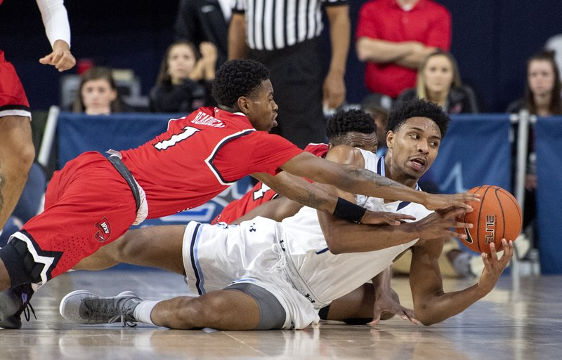 Old Dominion guard Jason Wade, right, competes for a loose ball with Western Kentucky guard Lamonte Bearden (1) during the first half of an NCAA college basketball game for the Conference USA men's tournament championship, Saturday, March 16, 2019, in Frisco, Texas. (AP Photo/Jeffrey McWhorter)