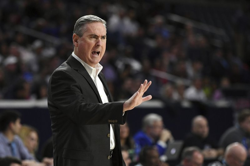 Western Kentucky coach Rick Stansbury calls out to his team during the first half of the team's NCAA college basketball game against Old Dominion for the Conference USA men's tournament championship Saturday, March 16, 2019, in Frisco, Texas. (AP Photo/Jeffrey McWhorter)