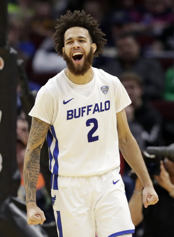 Buffalo's Jeremy Harris (2) celebrates after hitting a 3-point shot during the second half of the team's NCAA college basketball game against Bowling Green for the Mid-American Conference men's tournament title Saturday, March 16, 2019, in Cleveland. (AP Photo/Tony Dejak)